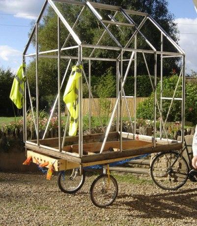 Ladder bike trailer carries green-house