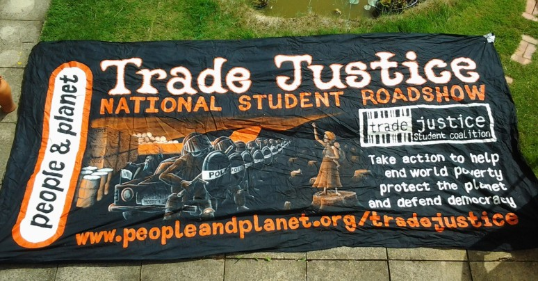 "Banner for ""Trade Justice"" national student roadshow 2001 for People and Planet"