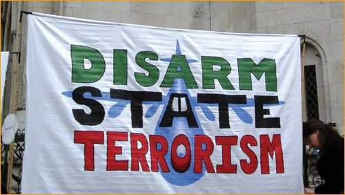 Disarm State Terrorism banner for the support group of the B52two, 2003