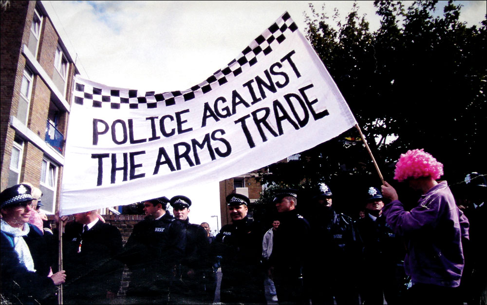 """""""Police against the arms trade"""" - banner used at the DSEi arms fair in London, on 11 Sept 2001"""
