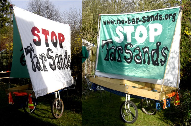 Banners mounted on the 'Ladder Bike trailer' as a mobile bill-board cum stall for a Demo against UK involvment in the Tar Sands, 2010