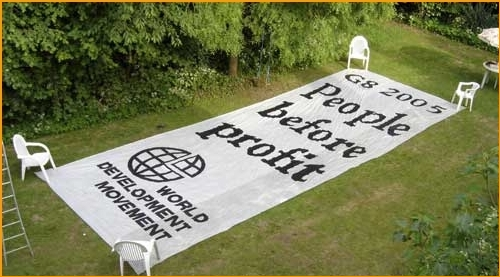 Banner for WDM, for the G8 meeting in 2005, painted in the beautiful garden of Grove House in Iffley.