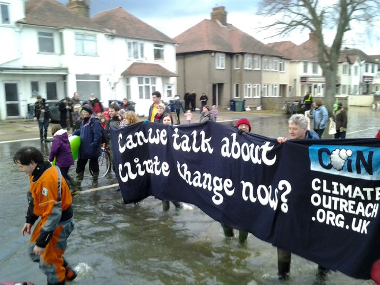 Can we talk about climate change now? A banner for COIN in February 2014